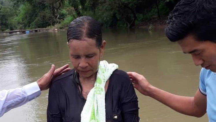Women baptized in river 2